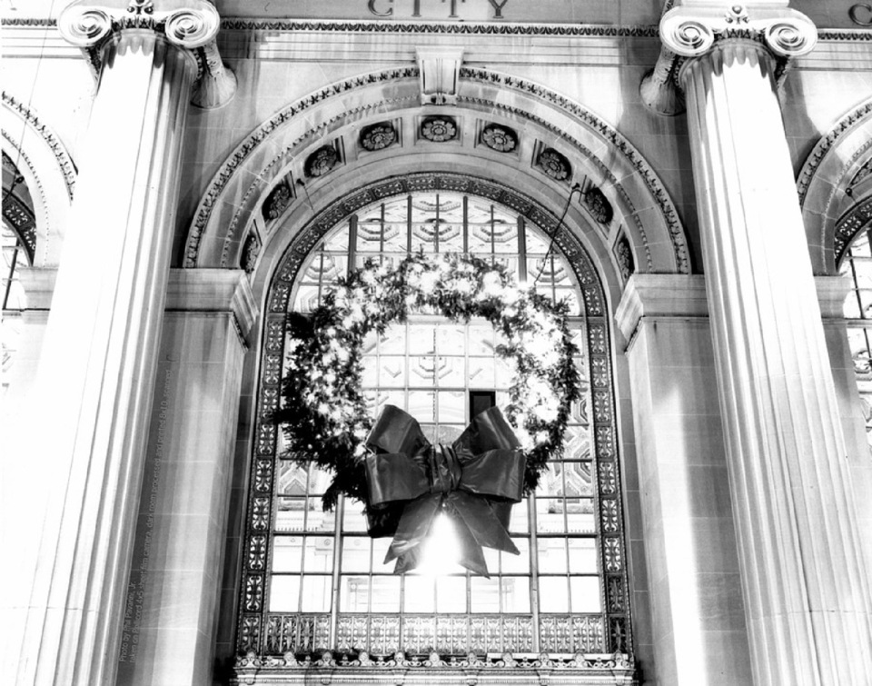 Huge wreath for a commercial palladian window on It's Ever Christmas website-blog